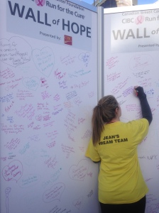 Marissa writing on the Wall of Hope