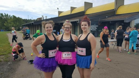 Sisters getting ready to run in tutus :)